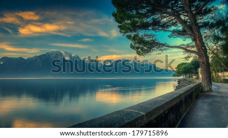 Early morning view of Lake Geneva HDR with dawn /vintage filter - stock photo