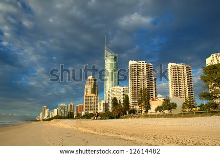 Early morning view of Surfers Paradise skyline on the Gold Coast Australia from the Northern end of the beach. - stock photo