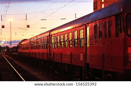 Early night at the railroad station - stock photo