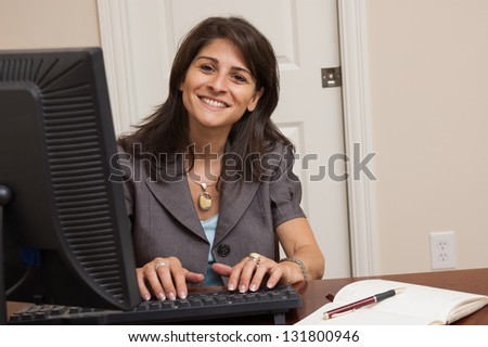 early 40s business woman working in her home office home office early