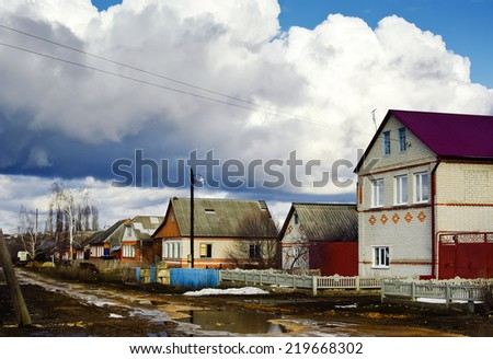 Early spring in the provincial village (rural settlement). - stock photo