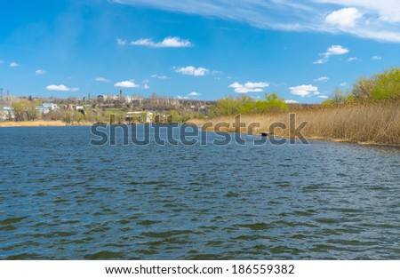 Early spring landscape with small Ukrainian river Sura - stock photo