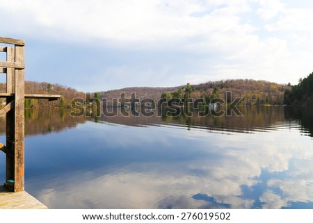Early spring morning on the Victoria day long weekend at the cottage on Lake of Bays, Muskoka, Ontario. - stock photo