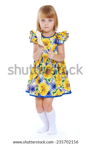 Early years, knowledge of the world, learning concept.Adorable little girl in a yellow dress.Isolated on white background. - stock photo