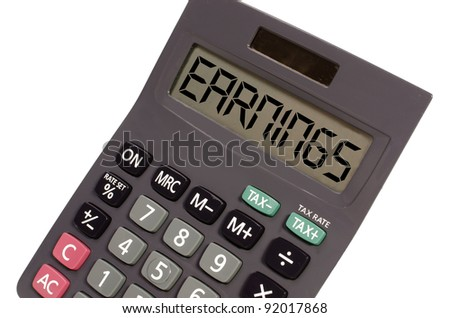 earnings written on display of an old calculator on white background in perspective - stock photo