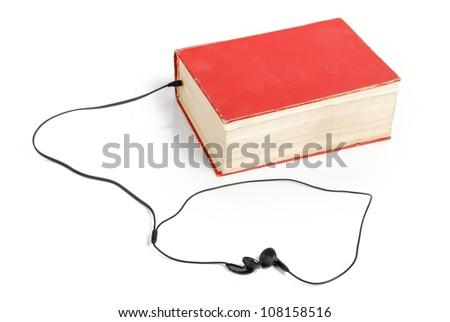 Earphone with book - stock photo
