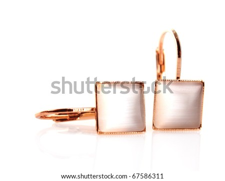 earring isolated on white - stock photo