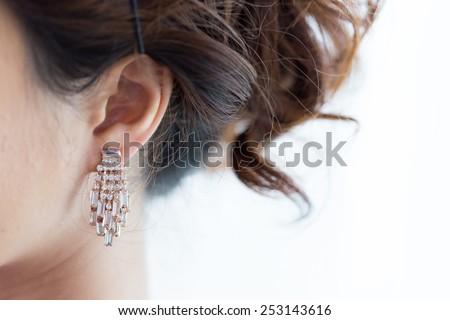earring luxury jewelry of beautiful woman - stock photo