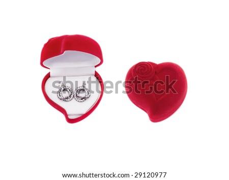 earrings in a heart shaped box - stock photo