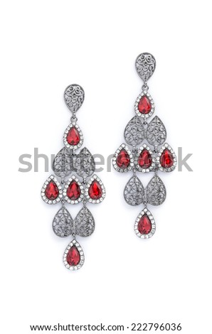 earrings with red rubies on a white background - stock photo