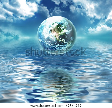 earth above the water - symbol of environmental protection - stock photo