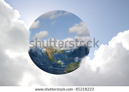 Earth and sky against a bright cloudy sky