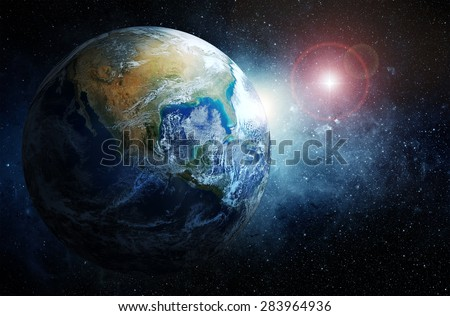 Earth and stars. Elements of this image furnished by NASA. - stock photo