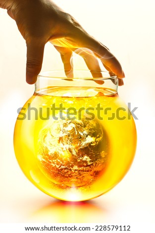 Earth burning in the bottle and yellow water boil under hand, Environment concept-Earth original image from NASA - stock photo