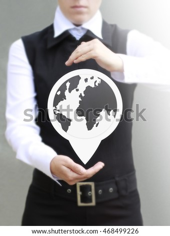 Earth button between the hands of a businessman. Businesswoman holds between the hands globe icon. Gps, glonass, navigation, buy, business, concept, positioning, location, travel, internet, www.