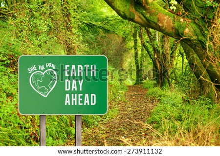 earth day ahead against peaceful autumn scene in forest - stock photo