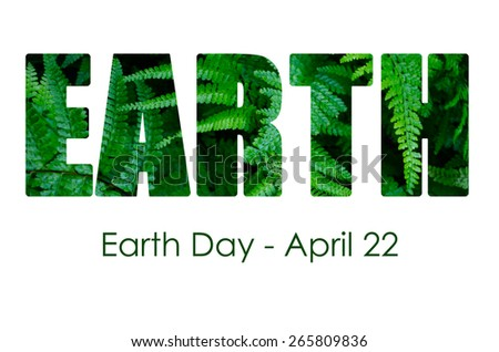 Earth Day, April 22, Concept with image of lush, green ferns within letters and sample greeting text. - stock photo