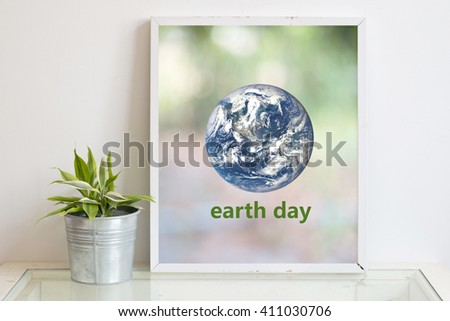 Earth Day on frame Background of this image furnished by nasa - stock photo