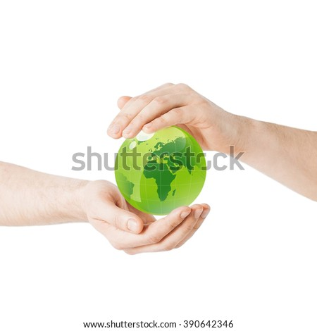 earth day, people, ecology and environment concept - close up of hands holding green globe - stock photo
