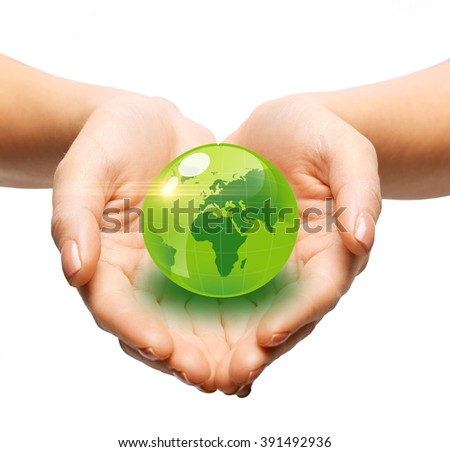 earth day, people, ecology and environment concept - close up of woman holding green globe in her hands