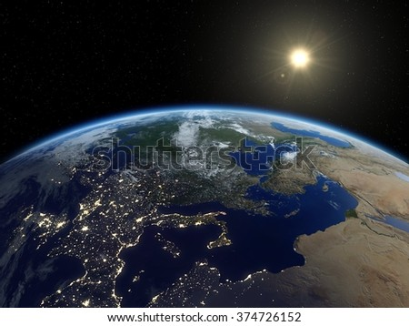 Earth from satellite. Beautiful sunrise over Europe. Earth at night and in daytime. 3D realistic illustration. (Elements of this image furnished by NASA.) - stock photo