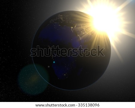 Earth from space Africa at night. Planet Earth in space with big bright sun with rays of light and stars on the background. - stock photo