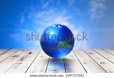 Earth glass ball  on old wood and on blue sky background .Earth day concept.Elements of this image furnished by NASA - stock photo