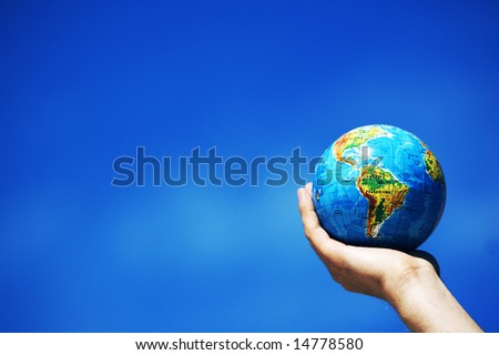 Earth globe in hand protected. Ideal for Earth protection concepts, recycling, world issues, enviroment themes
