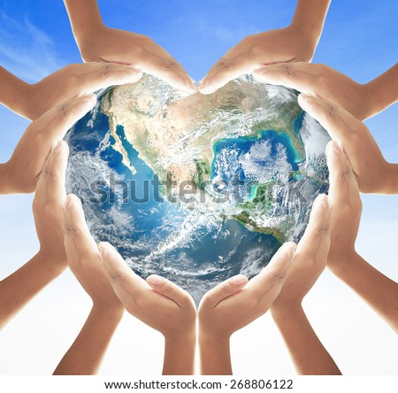Earth globe in 12 hands for heart shape over blue sky background. Environment, Earth Day, World Environment Day and Creation from God concept. Elements of this image furnished by NASA. - stock photo