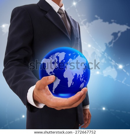 Earth Globe in his hand, safe world concept. - stock photo