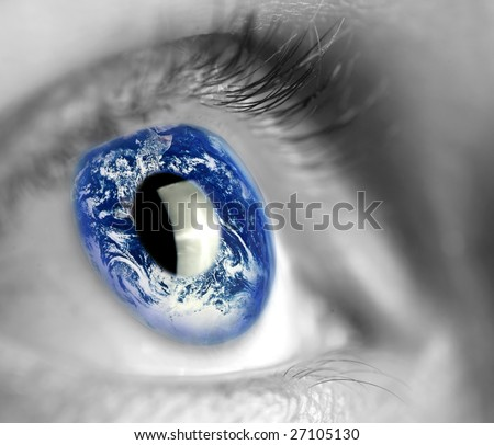 earth globe in woman's eye - stock photo