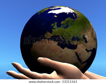 EARTH GLOBE - The precious planet Earth is held in caring hands.