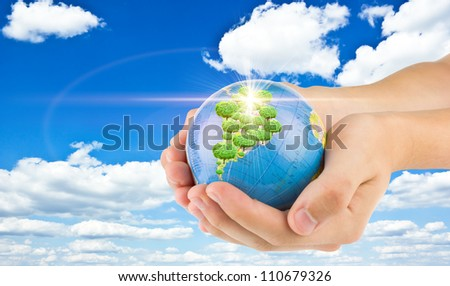 "earth in child""s hands - stock photo"