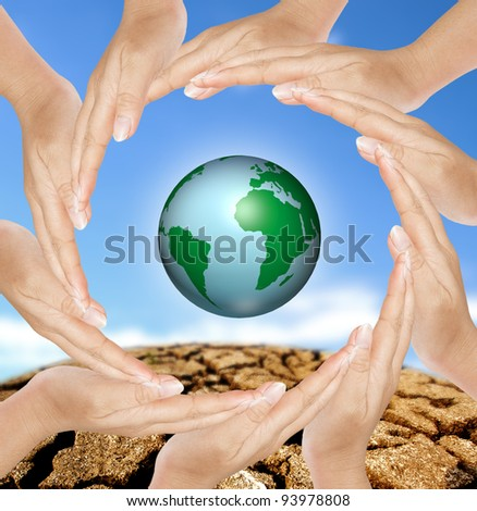 Earth in circle hands, concept of saving energy