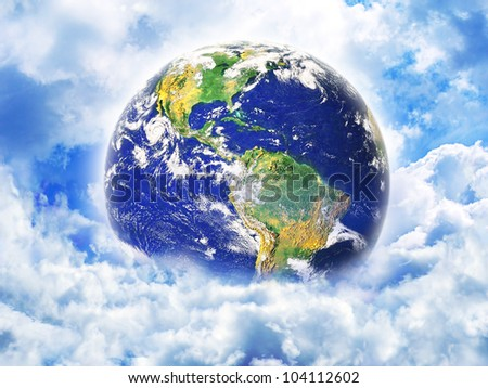 Earth in clouds. Elements of this image furnished by NASA. - stock photo