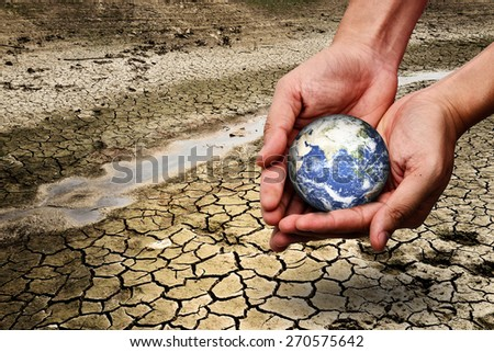 earth in hands - environment concept - elements of this image furnished by NASA - stock photo