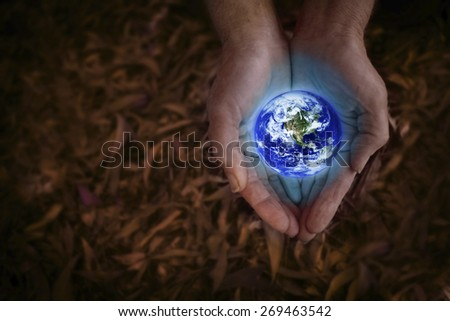 Earth in hands  Some components of this montage are provided courtesy of NASA, and have been found at http://visibleearth.nasa.gov.  - stock photo