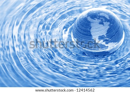 Earth in water - stock photo