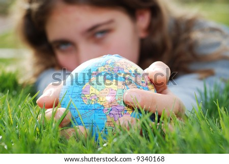 earth is being held by a little girl's hands(shows europe) - stock photo
