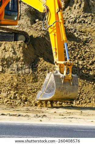 Earth mover working on road construction - stock photo