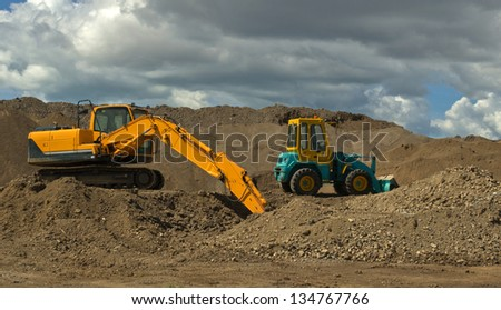 Earth moving machinery at work - stock photo