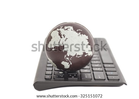 Earth on keyboard isolated on white - stock photo