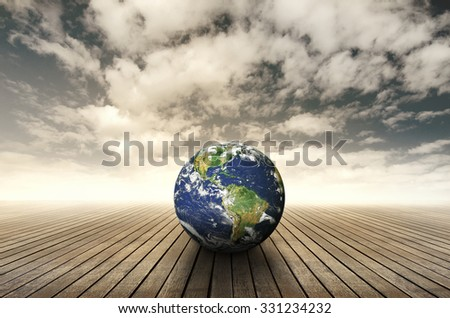 Earth on wood and sky background. Elements of this image furnished by NASA. - stock photo
