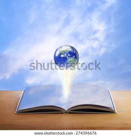 Earth over open book that has sky on it page on blue sky background, Elements of this image furnished by NASA  - stock photo