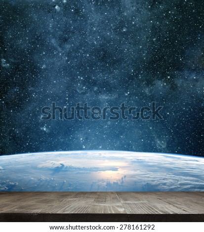 Earth planet with wooden floor. Elements of this image are furnished by NASA - stock photo