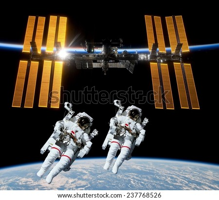 Earth satellite space station spaceship astronauts. Elements of this image furnished by NASA. - stock photo