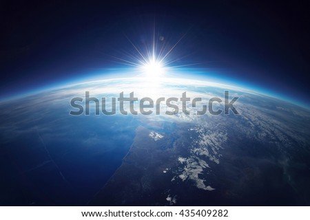 Earth view from space with sunrise. Photo is combination of real photo taken from weather balloon with some details furnished by NASA. - stock photo