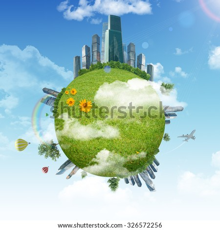 Earth with green grass and city and blue sky background