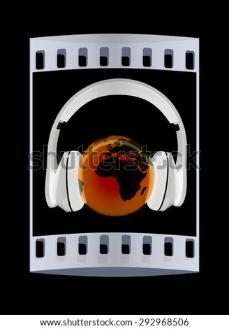 earth with headphones. World music concept isolated on black. The film strip - stock photo