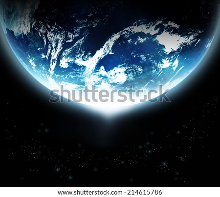 Earth with sun rising from space - original image from NASA.gov - stock photo